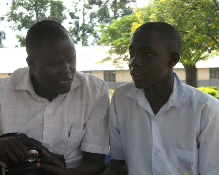 EEFC discusses academic issues with NUEP student Ochola Maxwel Alensio at St. Josephs Layibi 700x560 Education Slideshow